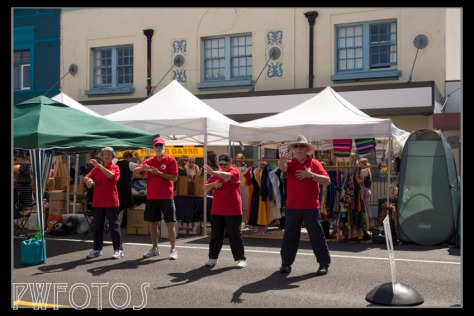 A group of older stallholders promoting tai-chi