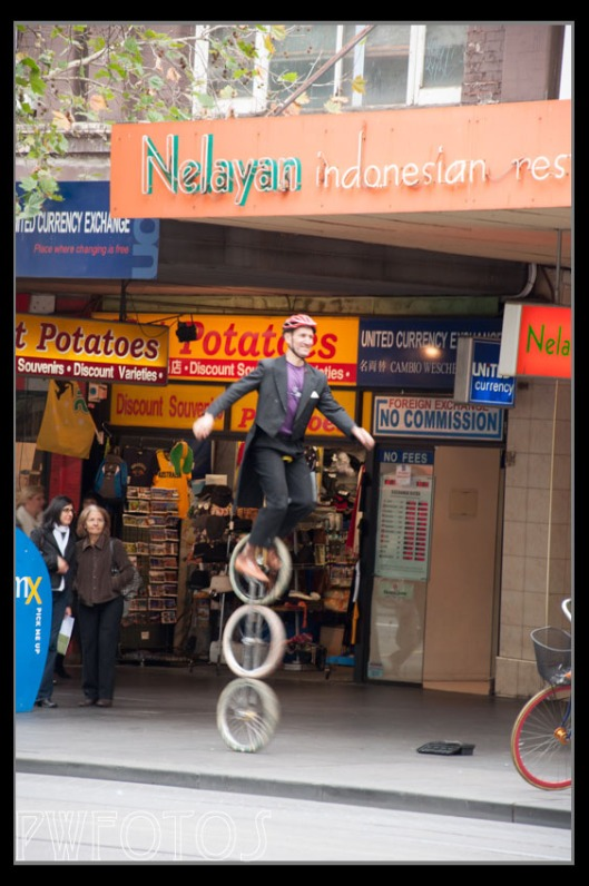 You don't expect to see tall unicycles in the middle of the city.