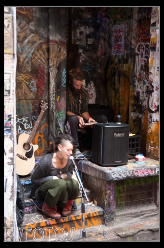 These two buskers were at the end of the a very dark alley on a rainy day