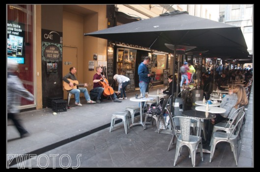 Street side cafes are in many of the alleys and so are buskers