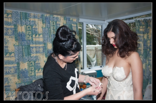 Tiffany starts the process of attaching the paper for my Paper Queen shoot