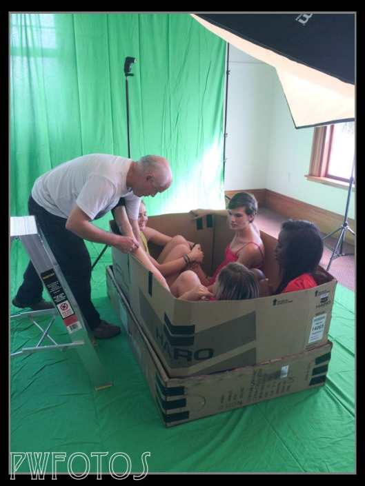 The models get comfortable in the box